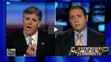"Sean Hannity & Yousef Munayyer with ""Sympathy for the Terrorists"" banner"